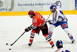 Jonathan Raymon Juliano (HK Acroni Jesenice, 53) vs Tomaz Razingar (EC Rekord Fenster VSV, #9) during ice-hockey match between HK Acroni Jesenice and EC Rekord Fenster VSV in 37th Round of EBEL league, on Januar 3, 2012 at Dvorana Podmezaklja, Jesenice, Slovenia. (Photo By Matic Klansek Velej / Sportida)