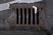 Maintenance Hole- and Drain Covers of Wirral by Colin McPherson, 2020-21.<br /> <br /> A maintenance hole (manhole) cover manufactured by Doulton of London, a company which was based in the Vauxhall or Lambeth area of the capital, but which no longer trades.