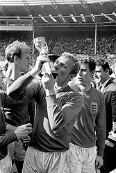 BOBBY MOORE PLANTS AN ENTHUSIASTIC KISS ON THE WORLD CUP TROPHY AFTER ENGLAND'S VICTORY OVER WEST GERMANY IN THE WORLD CUP 1966 TOURNAMENT FINAL IN WHICH ENGLAND WON 4-2 AFTER EXTRA TIME. AT WEMBLEY STADIUM IN LONDON.(07/10/2000)The last football game ever to played at the famous Wembley Stadium, with a match held between England and Germany.  *191201: Bobby Moore planting an enthusiastic kiss on the World Cup trophy after England's historic victory over West Germany in the World Cup 1966 tournament final in which England won 4-2 at Wembley Stadium.  In an announcement,  Culture Secretary Tessa Jowell confirmed that Wembley would be the site of a new national stadium.