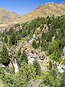 Looking across Skipper's Canyon and the Shotover River, with a waterfall, near Queenstown, Otago, New Zealand.  Skipper's Canyon is an historical gold mining area of the Otago Region.