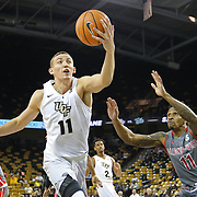 ORLANDO, FL - NOVEMBER 15: Rokas Ulvydas #11 of the UCF Knights grabs a rebound in front of David Efianayi #11 of the Gardner Webb Runnin Bulldogs during a NCAA basketball game at the CFE Arena on November 15, 2017 in Orlando, Florida. (Photo by Alex Menendez/Getty Images) *** Local Caption *** Rokas Ulvydas;  David Efianayi