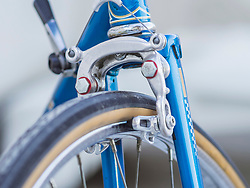 Close-up of retro bicycle front wheel with gear