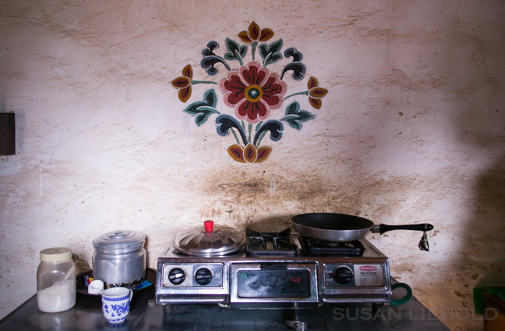 A small gas burner is the main cooking source in this home in Bhutan.