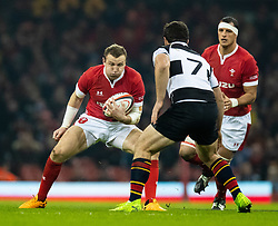 Hadleigh Parkes of Wales under pressure from Marco Van Staden of Barbarians <br /> <br /> Photographer Simon King/Replay Images<br /> <br /> Friendly - Wales v Barbarians - Saturday 30th November 2019 - Principality Stadium - Cardiff<br /> <br /> World Copyright © Replay Images . All rights reserved. info@replayimages.co.uk - http://replayimages.co.uk