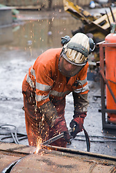 Burner processing heavy steel to works furnace size at a metal recycling centre,