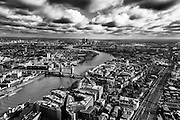 Ariel view of Wapping, Tower Bridge, Shad Thames and the River Thames in London.