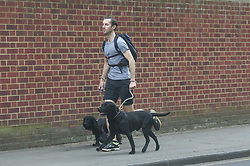 EXCLUSIVE ALL ROUNDER James Matthews takes his dog, and sister-in-law Kate's dog, for a jog just four days before his wedding to Pippa Middleton. One of the dogs relieves itself on a lamp post which an elderly woman was standing next to. James apologised to the lady before hurrying off.<br /> <br /> 16 May 2017.<br /> <br /> Please byline: Vantagenews.com
