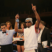 "Willie Monroe Jr. celebrates his victory over Vitali Kopylenko during the ESPN ""Boxcino"" boxing tournament at Turning Stone Resort Casino on Friday, April 18, 2014 in Verona, New York.  (AP Photo/Alex Menendez)"