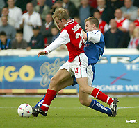 Photo. Andrew Unwin<br /> Rotherham v Millwall, Nationwide League Division One, Millmoor Lane, Rotherham 11/10/2003.<br /> Millwall's Tony Craig (r) tries to tackle Rotherham's Chris Sedgwich (l).