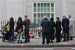 © licensed to London News Pictures. London, UK 07/07/2012. 7/7 victims being remembered as the families visit the memorial in Tavistock Square on attack's 7th anniversary. Fifty-two people, as well as the four bombers, were killed in the London bombing attacks, and over 700 more were injured. Photo credit: Tolga Akmen/LNP