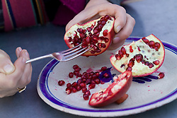 Extracting pomegranate seeds with a fork