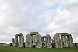 Over one hundred people, including local residents, climate and land justice activists and pagans, take part in a Mass Trespass at Stonehenge on 5 December 2020 in Salisbury, United Kingdom. The trespass was organised in protest against the approval by Transport Secretary Grant Shapps of a £1.7bn project for a two-mile tunnel beneath the World Heritage Site and a further eight miles of dual carriageway for the A303, as well as the government's £27bn Road Investment Strategy 2 (RIS2).