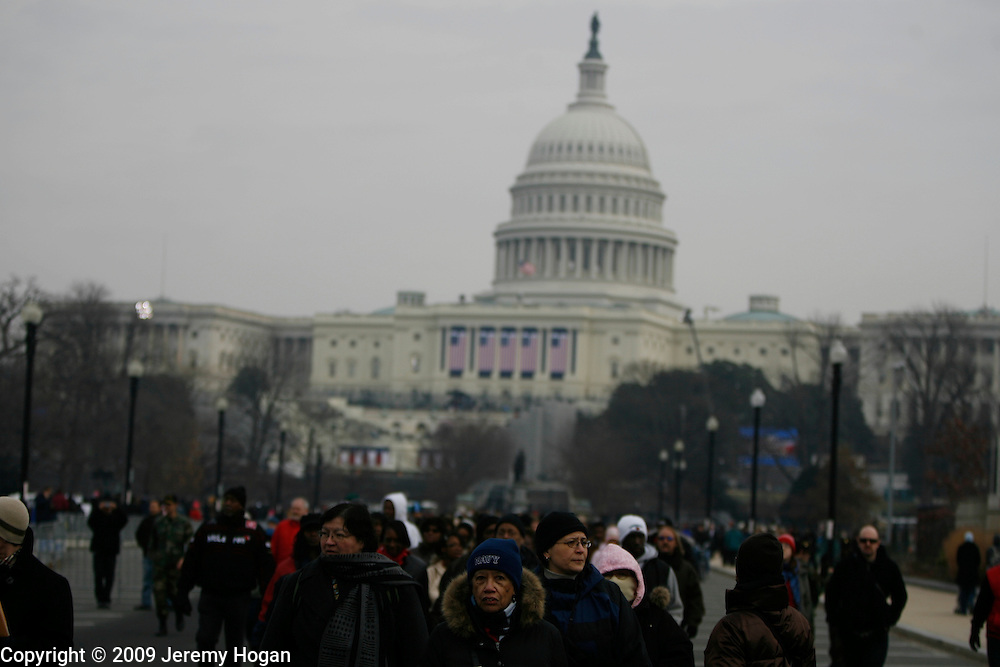 Throngs of people walk near the United States Capital building where Barack Obama will be sworn in as president Tuesday.