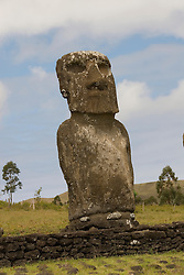 Chile, Easter Island: Statues or moai on a platform or ahu at Ahu Akivi, an inland array of moai, unusual because most moai face inland from the edge of the sea..Photo #: ch301-33142..Photo copyright Lee Foster www.fostertravel.com lee@fostertravel.com 510-549-2202