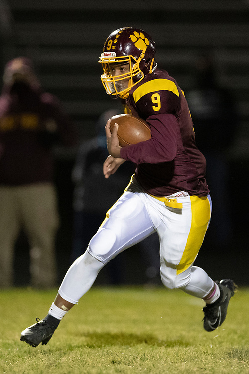 Brandywine's Michael Palmer runs with the ball for yardage during the Comstock-Brandywine high school football game on Friday, October 30, 2020, at Selge Field in Niles, Michigan.
