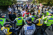 Far-right anti-immigration protesters are being dispersed by Kent Police after some of them clashed earlier in Dover on Saturday, Sept 5, 2020. At least 100 officers were at the scene on the A20 while protesters block the road and shout 'England 'till I die'. Fears of violence were voiced and local MP Natalie Elphicke pleaded for people to 'stay away' over COVID fears. Several officers were seen restraining one person on the ground before arresting them near Dover Marina. (VXP Photo/ Vudi Xhymshiti)