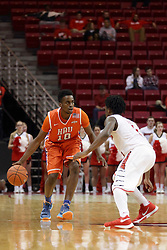 21 November 2015: Paris Lee(1) challenges Trey Patterson(10) at half court. Illinois State Redbirds host the Houston Baptist Huskies at Redbird Arena in Normal Illinois (Photo by Alan Look)
