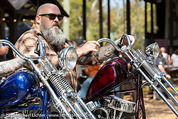 "Jeffrey Gillis on his 1950 Harley-Davidson custom 12"" over Panhead chopper at Warren Lane's True Grit Antique Gathering bike show at the Broken Spoke Saloon in Ormond Beach during Daytona Beach Bike Week, FL. USA. Sunday, March 10, 2019. Photography ©2019 Michael Lichter."