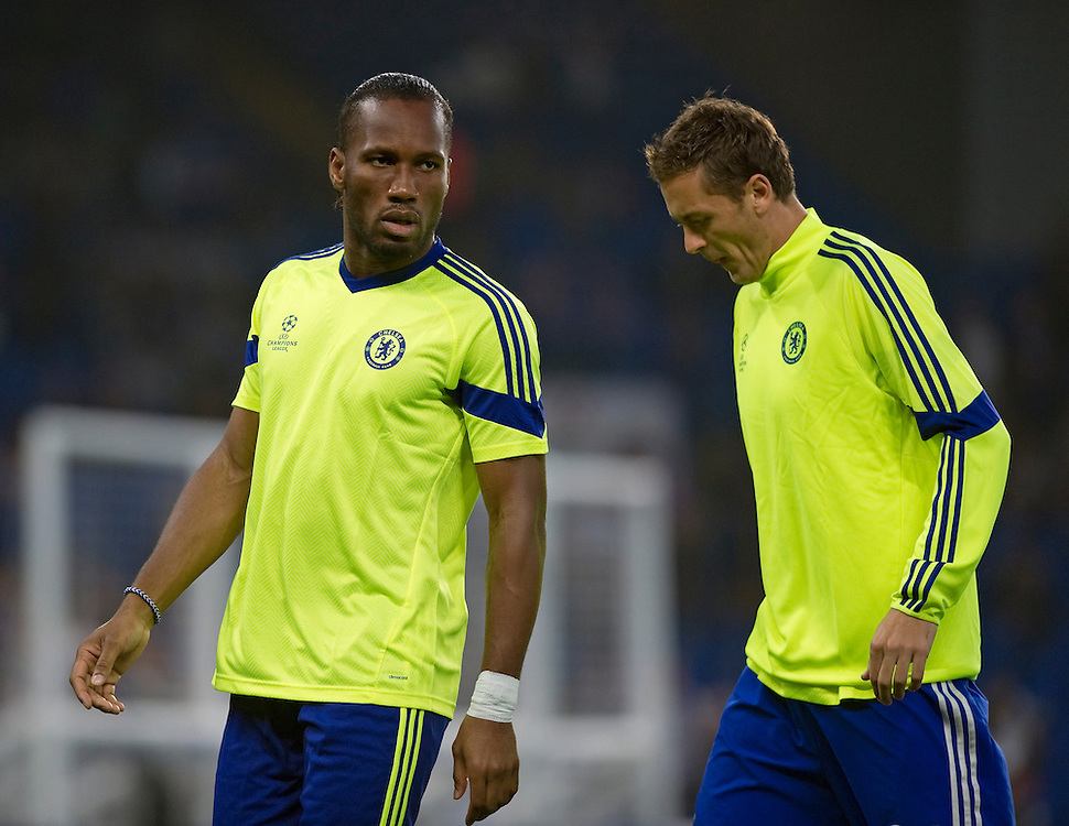 Chelsea's Didier Drogba during the pre-match warm-up with Nemanja Matic<br /> <br /> Photographer Ashley Western/CameraSport<br /> <br /> Football - UEFA Champions League Group G - Chelsea v Schalke - Wednesday 17th September 2014 - Stamford Bridge - London<br /> <br /> © CameraSport - 43 Linden Ave. Countesthorpe. Leicester. England. LE8 5PG - Tel: +44 (0) 116 277 4147 - admin@camerasport.com - www.camerasport.com