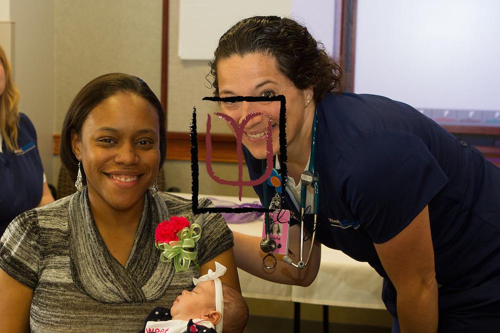 NICU nurse, Valerie Holmes, visits with Tranisha Misenheimer and infant daughter, Zyan born at 33 weeks gestation.
