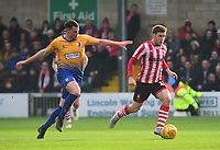 Lincoln City's Shay McCartan under pressure from Mansfield Town's Matt Preston<br /> <br /> Photographer Andrew Vaughan/CameraSport<br /> <br /> The EFL Sky Bet League Two - Lincoln City v Mansfield Town - Saturday 24th November 2018 - Sincil Bank - Lincoln<br /> <br /> World Copyright © 2018 CameraSport. All rights reserved. 43 Linden Ave. Countesthorpe. Leicester. England. LE8 5PG - Tel: +44 (0) 116 277 4147 - admin@camerasport.com - www.camerasport.com