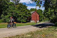 Bicycle touring along the Sheyenne Scenic Byway in Fort Ransom, North Dakota, USA
