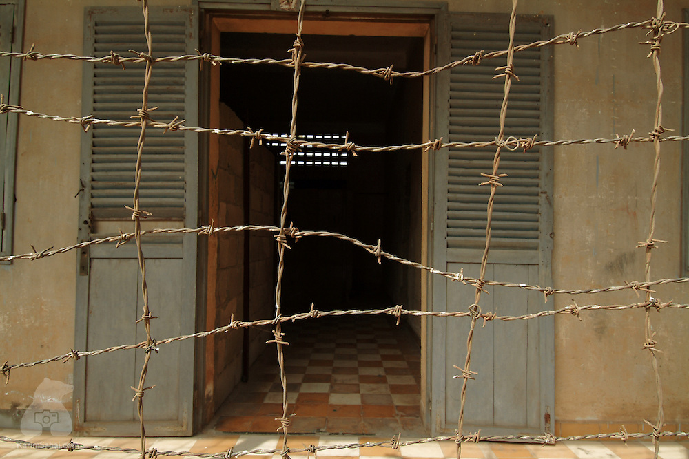 A barbwire mesh at the 'Tuol Sleng' genocide museum in Phnom Penh, Cambodia. Originally a school, the infamous 'S-21' compound was used as a prison in which at least 14,000 people were tortured and killed during the Khmer Rouge regime. On July 26, 2010, Kaing Guek Eav -  Tuol Sleng's overseer and chief executionner -  was found guilty by a United Nation-backed war crimes tribunal and sentenced to 35 years in prison.