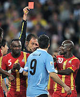Football - World Cup Finals 2010 Uruguay v Ghana<br />     2/07/2010 1/4 Final Luis Suarez (Urg ) receives the red card and is sent off by referee, Olegario Benquerenca.<br /> @ Soccer City : Colorsport / Andrew Cowie