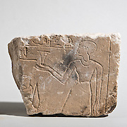 An Egyptian Limestone fragment of a relief 1st millennium BCE