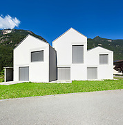 architecture, three white houses, view from the road