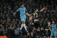 Leroy Sané (Manchester City) and Mikael Lustig (Celtic)  during the Champions League match between Manchester City and Celtic at the Etihad Stadium, Manchester, England on 6 December 2016. Photo by Mark P Doherty.