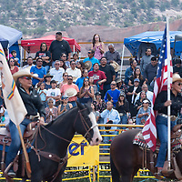 Fans stand during for the colors during the 72nd annual Navajo Nation Fair Rodeo Finals in Window Rock.