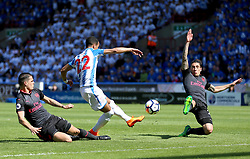 Huddersfield Town's Tom Ince (centre) misses a chance on goal