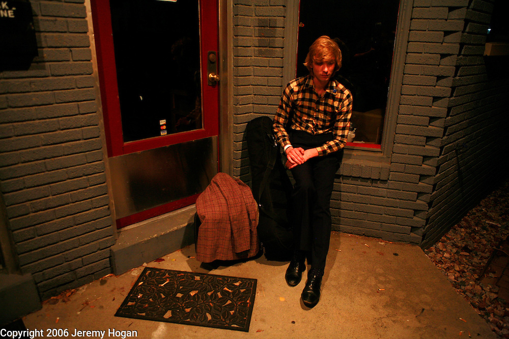 Folk pop singer songwriter Jeremy Jay, of Los Angeles, sits outside Landlocked Records before playing an acoustic show in a basement down the street.