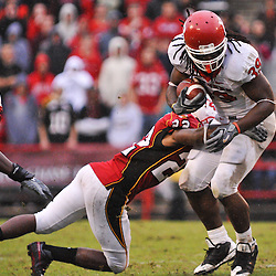 Sep 26, 2009; College Park, MD, USA; Maryland defensive back Cameron Chism (22) tackles Rutgers running back Jourdan Brooks (39) during the second half of Rutgers' 34-13 victory over Maryland in NCAA college football at Byrd Stadium.