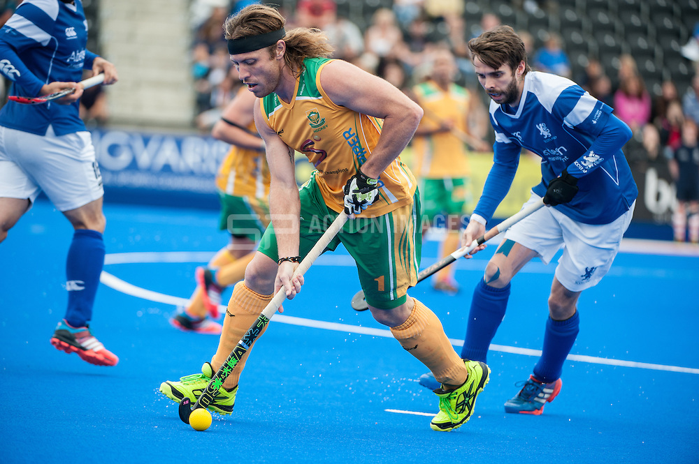Jonty Robinson (RSA) is shadowed by Ross Stott (SCO). Scotland v South Africa, 3rd/4th play-off, Investec London Cup, Lee Valley Hockey & Tennis Centre, London, UK on 13 July 2014. Photo: Simon Parker