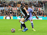 NEWCASTLE UPON TYNE, ENGLAND - SEPTEMBER 17: Miguel Almiron of Newcastle United and Junior Firpo of Leeds United during the Premier League match between Newcastle United and Leeds United at St. James Park on September 17, 2021 in Newcastle upon Tyne, England. (Photo by MB Media)