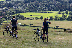 Licensed to London News Pictures. 17/09/2021. Dorking, UK. Cyclists enjoy the late September sun on Box Hill in Surrey as weather forcasters predict a warmer few days ahead with highs of 24c tomorrow for London and the South East. Photo credit: Alex Lentati/LNP