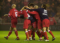 Photo. Glyn Thomas.<br /> Middlesbrough v Everton. Carling Cup Round 4.<br /> Riverside Stadium, Middlesbrough. 03/12/2003.<br /> Boro players mob Mendieta after he won the match on penalties.