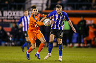 Luton Town forward Aron Jarvis (27) battles with Sheffield Wednesday defender Jordan Thorniley (12) during the The FA Cup 3rd round replay match between Luton Town and Sheffield Wednesday at Kenilworth Road, Luton, England on 15 January 2019.