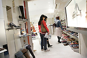 girls shopping for shoes Tokyo Japan