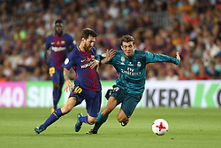 August 13, 2017 - Barcelona, Spain - Lionel Messi of FC Barcelona duels for the ball with Mateo Kovacic of Real Madrid during the Spanish Super Cup football match between FC Barcelona and Real Madrid on August 13, 2017 at Camp Nou stadium in Barcelona, Spain. (Credit Image: © Manuel Blondeau via ZUMA Wire)