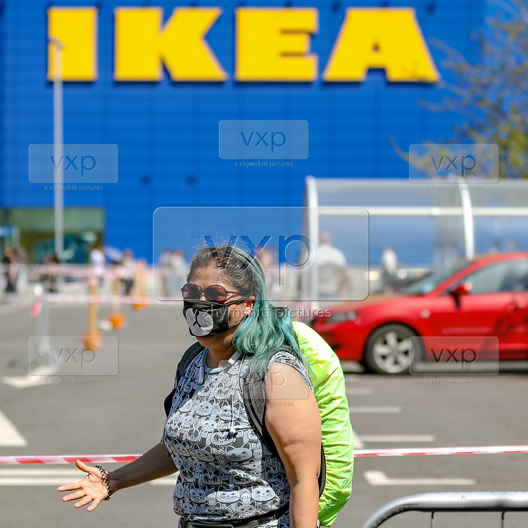 A customer wearing a face mask resembling Panda face, queuing at the IKEA Greenwich store in South London as it reopens to the public following the introduction of measures to bring England out of lockdown, Monday, Jun 1, 2020. (Photo/ Vudi Xhymshiti)