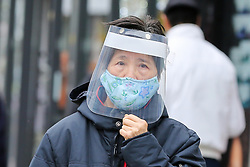 © Licensed to London News Pictures. 30/10/2020. London, UK. A woman wearing a face shield and a face covering in north London. Pressure is mounting on the Prime Minister Boris Johnson and Ministers to impose a second national lockdown and London is likely to go into Tier 3 in the coming weeks as coronavirus cases are increasing. Photo credit: Dinendra Haria/LNP