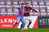 Aaron Lyall (#19) of Inverness Caledonian Thistle FC shields the ball from Michael Smith (#2) of Heart of Midlothian FC during the SPFL Championship match between Heart of Midlothian and Inverness CT at Tynecastle Park, Edinburgh Scotland on 24 April 2021.