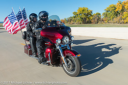 Micheline and Fred Nelson, USAF and American Legion Rider in Spearfish Chapter 164 on their 2016 Harley-Davidson Ultra Limited ride the USS South Dakota submarine flag relay across South Dakota on the first day from Sturgis to Aberdeen. SD. USA. Saturday October 7, 2017. Photography ©2017 Michael Lichter.