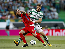 August 15, 2017 - Lisbon, Portugal - Steaua's forward Denis Alibec (L) vies for the ball with Sporting's defender Sebastian Coates (R)  during Champions League 2017/18, first playoff round match between Sporting CP vs FC Steaua Bucuresti, in Lisbon, on August 15, 2017. (Credit Image: © Carlos Palma/NurPhoto via ZUMA Press)