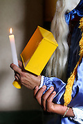 Inhauma_MG, Brasil...Folia de Reis em uma casa no Distrito dos Maias em Inhauma, na foto uma pessoa com adereco segurando uma vela...Folia de Reis in a house in the Distrito dos Maias in Inhauma, in this photo a person with the typical fantasy holding a candle...Foto: LEO DRUMOND / NITRO