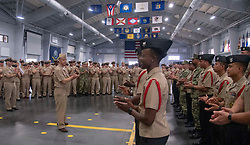 GREAT LAKES, Ill. (Aug. 7, 2018) Capt. Erik Thors, commanding officer of Recruit Training Command (RTC), congratulates the RTC chief petty officer selectees and the chiefs mess in the Pacific Fleet drill hall at RTC. Sixty-eight RTC first class petty officers were selected for chief. More than 30,000 recruits graduate annually from the Navy's only boot camp. (U.S. Navy photo by Mass Communication Specialist 2nd Class Spencer Fling)180807-N-PL946-1017