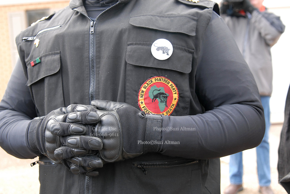 Members of The New Black Panthers Movement line up outside the LaSalle County Courthouse during a protest on Martin Luther King Day .A group of protesters march to Jena High School on the Martin Luther King Jr. holiday in Jena, La., Monday, Jan. 21, 2008. The protest was organized by the self-described 'pro-majority' Nationalist Movement of Learned, Mississippi, lead by Richard Barrett, and was being held in opposition to the six black teenagers who were arrested in the beating of a white classmate in December 2006, and the King holiday. The protest drew about 50 participants and 100 counter-demonstrators to Jena.(Photo/© Suzi Altman)